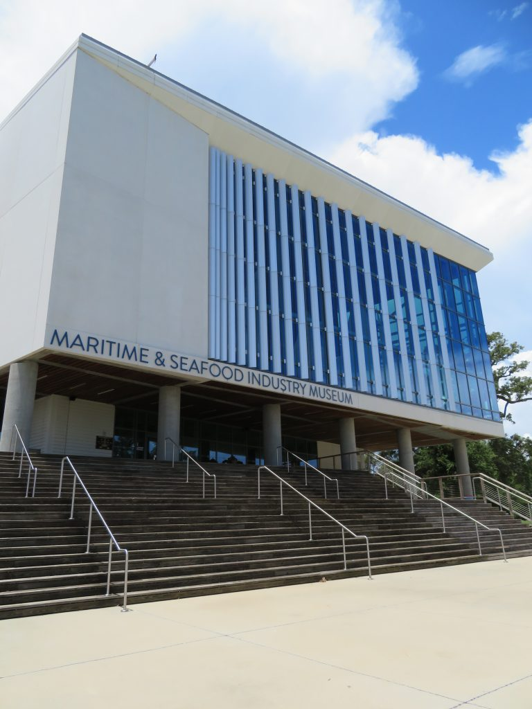 "Overview of a large museum with sign that says ""Maritime & Seafood Industry Museum,"" which is one of five family-friendly Mississippi Gulf Coast activities."