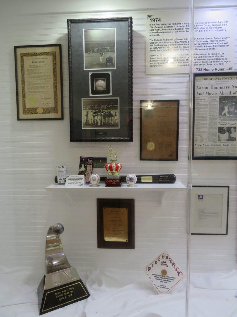 Exhibit showing memorabilia commemorating Hank Aaron's 715th home run.