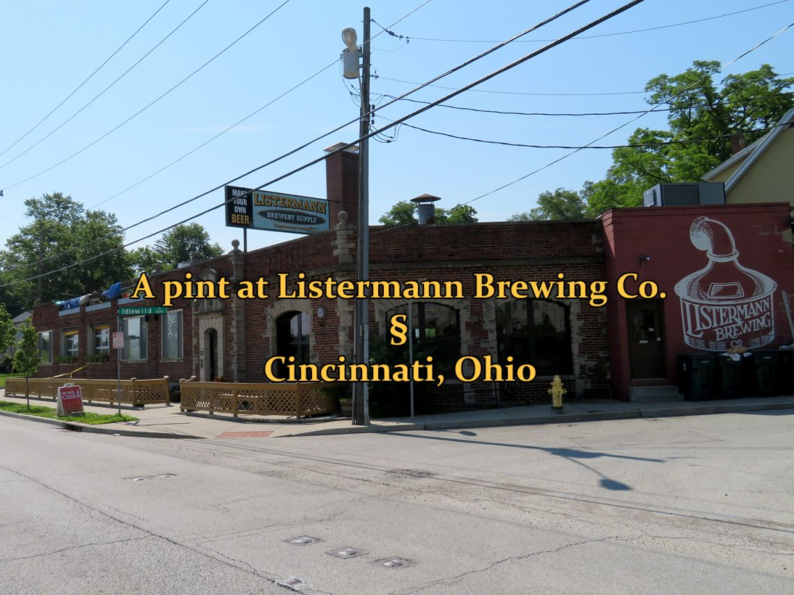 "A photo of a brick building at a street intersection with text overlay that reads ""A pint at Listermann Brewing Co. in Cincinnati, Ohio."""