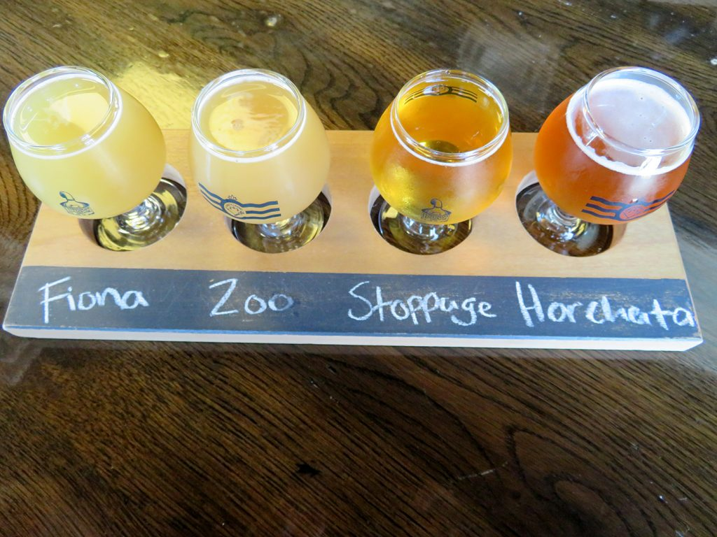 A flight board with four tasters of light beers at Listermann Brewing Company.
