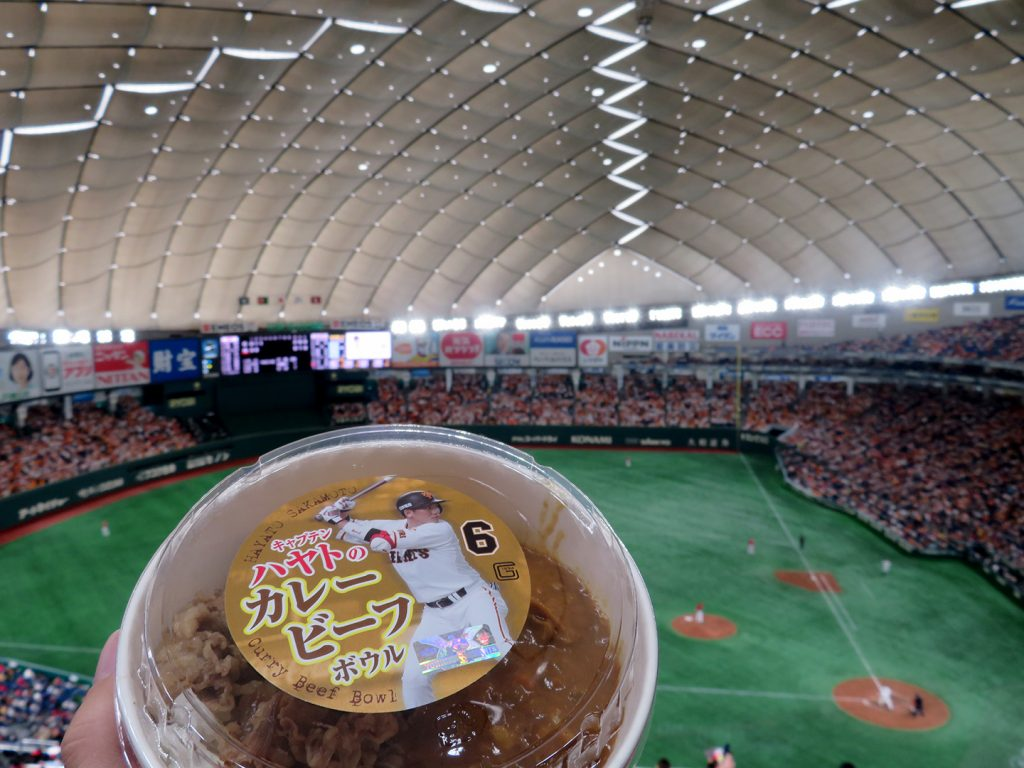 A large cardboard bowl with a sticker of Yomiuri Giants player Hayato Sakamoto on the plastic lid.