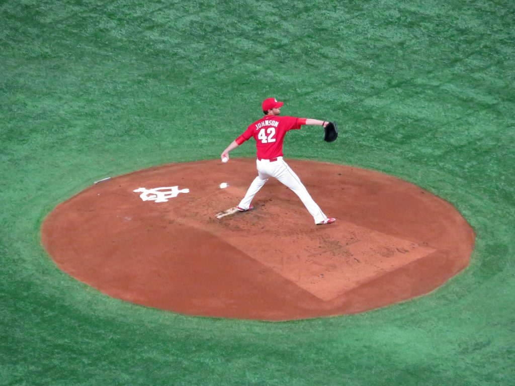 American Hiroshima Toyo Carp pitcher Kris Johnson delivers a pitch.