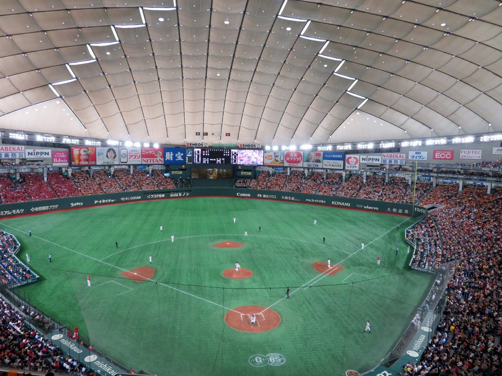 An overview of a baseball field at Tokyo Dome as seen from behind home plate.