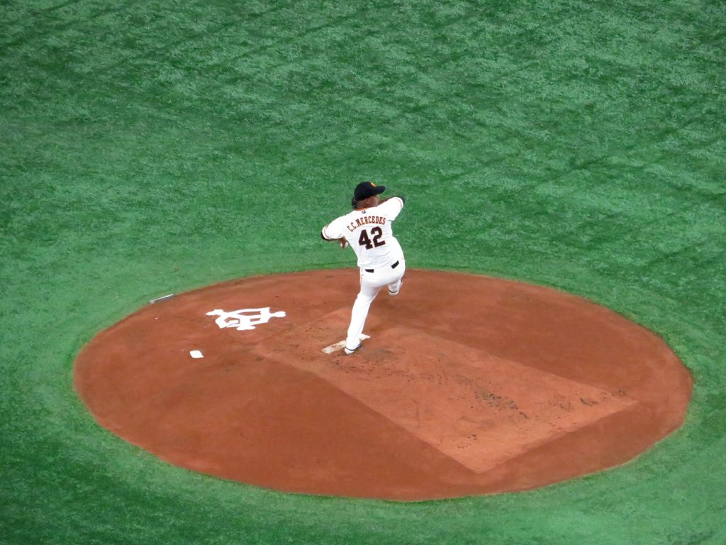 Left-handed Yomiuri Giants pitcher C.C. Mercedes winds up to deliver a pitch.