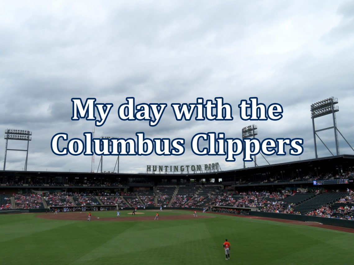 "Overview of a baseball stadium with letters above the rooftop that spell out ""Huntington Park"" with text overlaid that says ""My day with the Columbus Clippers."""