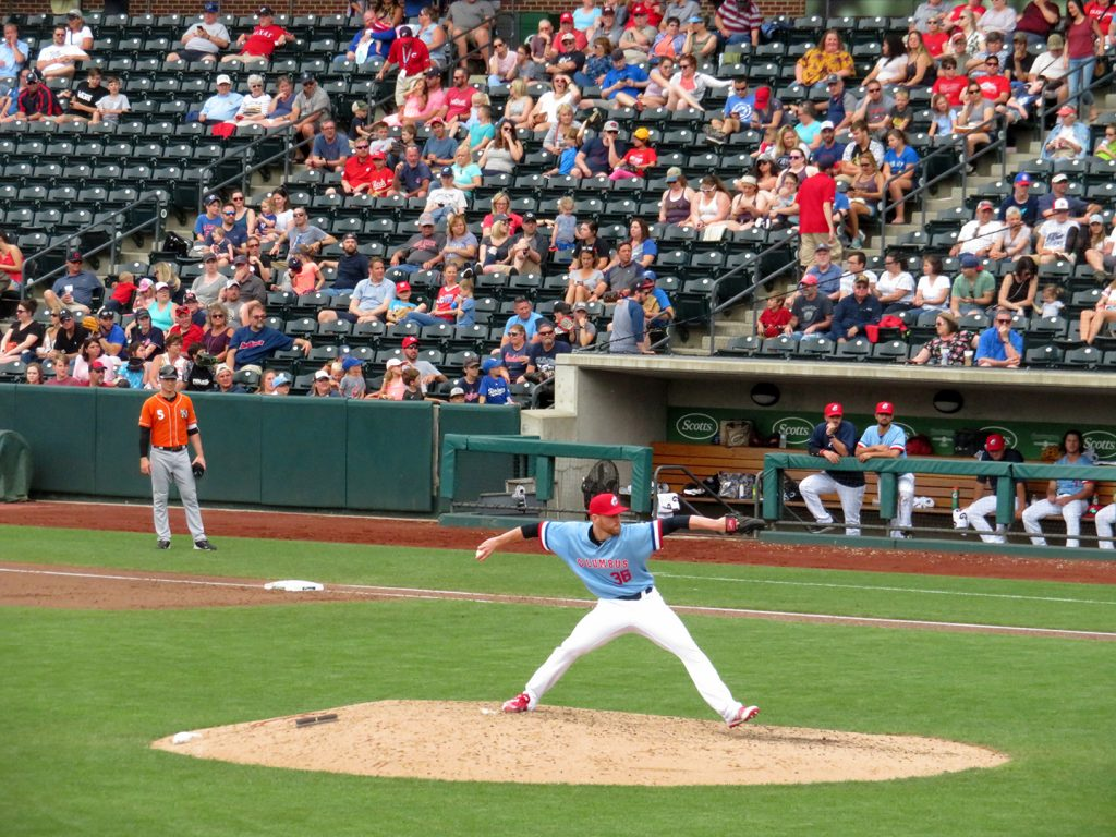 Columbus Clippers right-handed pitcher Brooks Pounders delivers a pitch during a game.