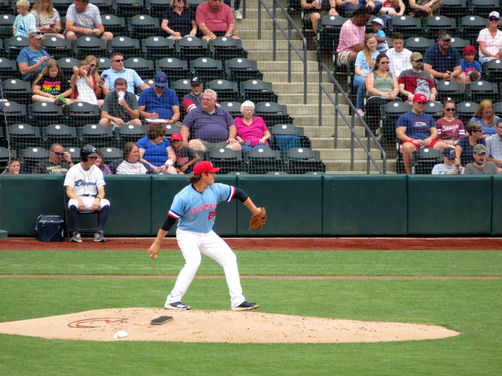 Columbus Clippers right-handed pitcher Asher Wojciechowski delivers a pitch during a baseball game.