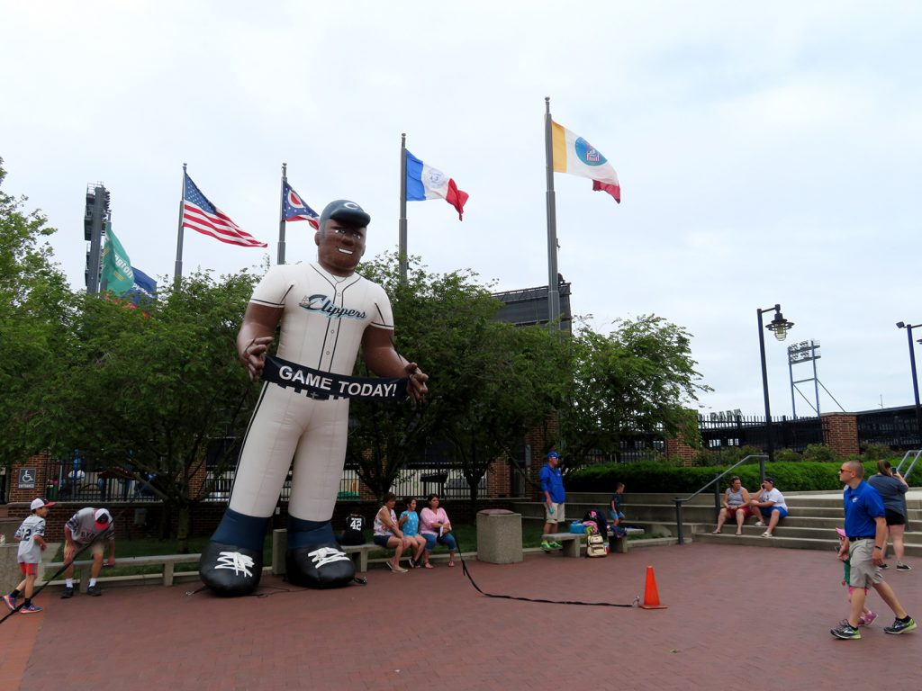 "A large inflatable baseball player holding a banner that says ""Game Today!"" welcomes fans to Huntington Park, home of the Columbus Clippers."