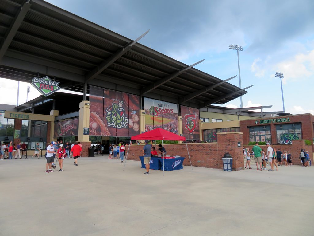 "Banners that say ""Gwinnett Stripers"" above entrances to Coolray Field."