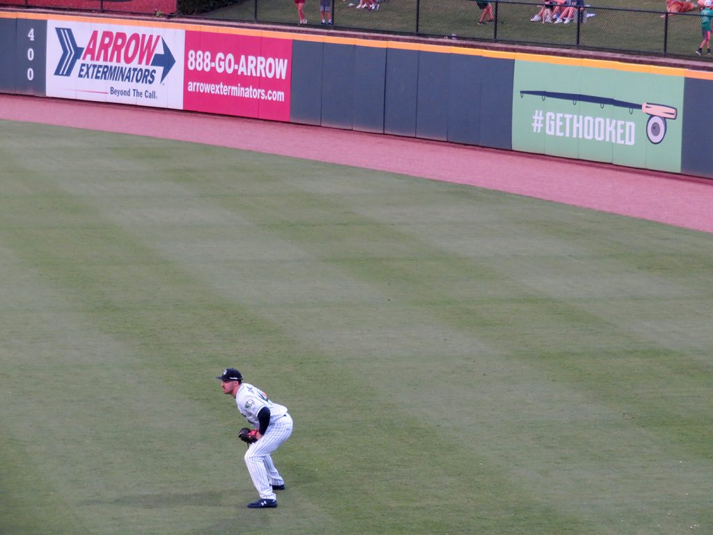 Gwinnett Stripers outfielder Adam Dunn crouches while waiting for a ball to be hit his way.