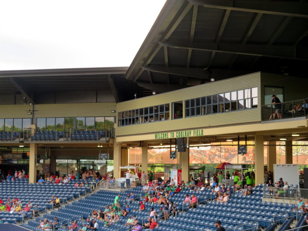 "Grandstand of a baseball stadium with text says ""Welcome to Coolray Field."""