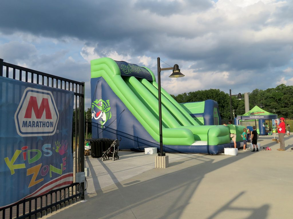 Large inflatable slide and other items on cement pavement.