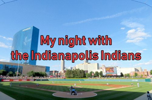 "Overview of a baseball field with the Indianapolis skyline behind it. Text overlays the image that says ""My night with the Indianapolis Indians."""