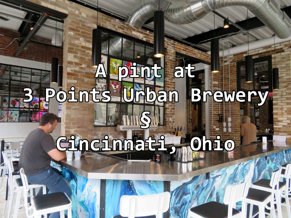 "Diagonal view of a bar top with text overlaying that says ""3 Points Urban Brewery (Section Sign) Cincinnati, Ohio."""