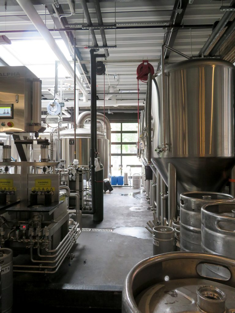 Row of fermentation tanks on the right with the brewhouse for 3 Points to the left.