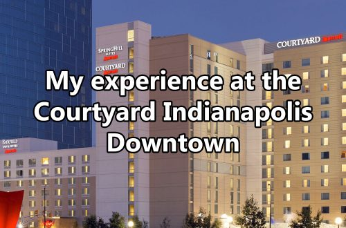 "Overview of multiple 12-story buildings with text overlaying image that says ""My experience at the Courtyard Indianapolis Downtown."""
