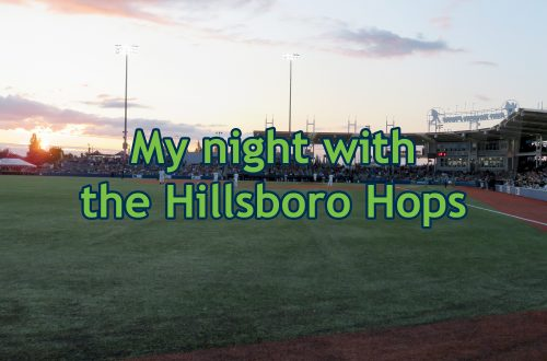 "Overview of a baseball stadium from the outfield facing the grandstand with text overlaying the image that says ""My night with the Hillsboro Hops."""