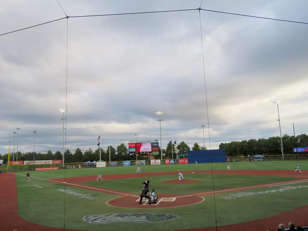 Hillsboro Hops left-handed pitcher Tommy Henry throws the first pitch of a baseball game.