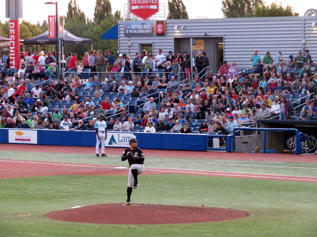 Salem-Keizer Volcanoes right-handed pitcher Jesus Ozoria prepares to deliver a pitch against the Hillsboro Hops.