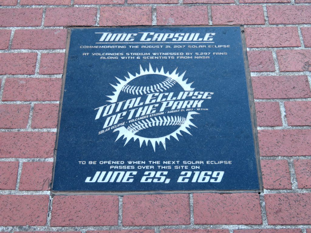 Black stone plaque for a time capsule buried to commemorate the August 21, 2017, total solar eclipse that passed over Volcanoes Stadium.