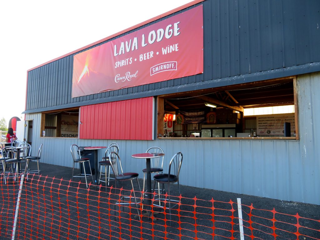 "Metal trailer with two openings below a banner that says ""Lava Lodge."""