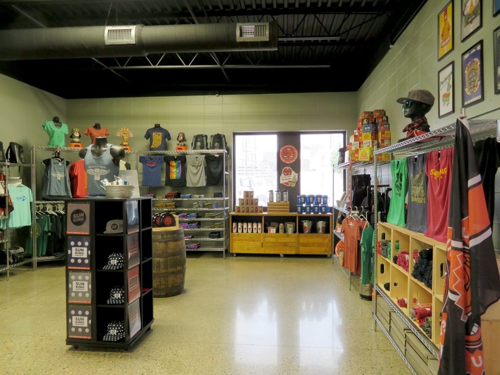 Large space with t-shirts on display to the left and right at Sun King Brewery.