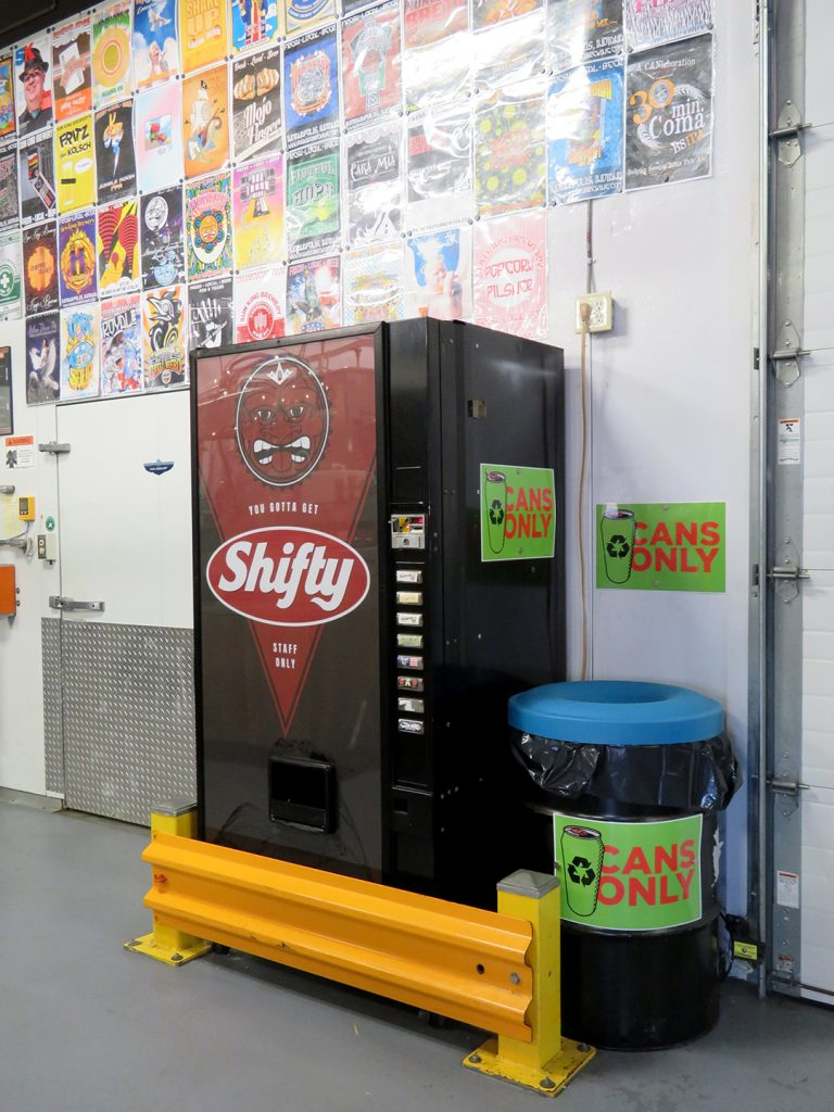 "A vending machine with ""Shifty"" on the panel for brewery staff."