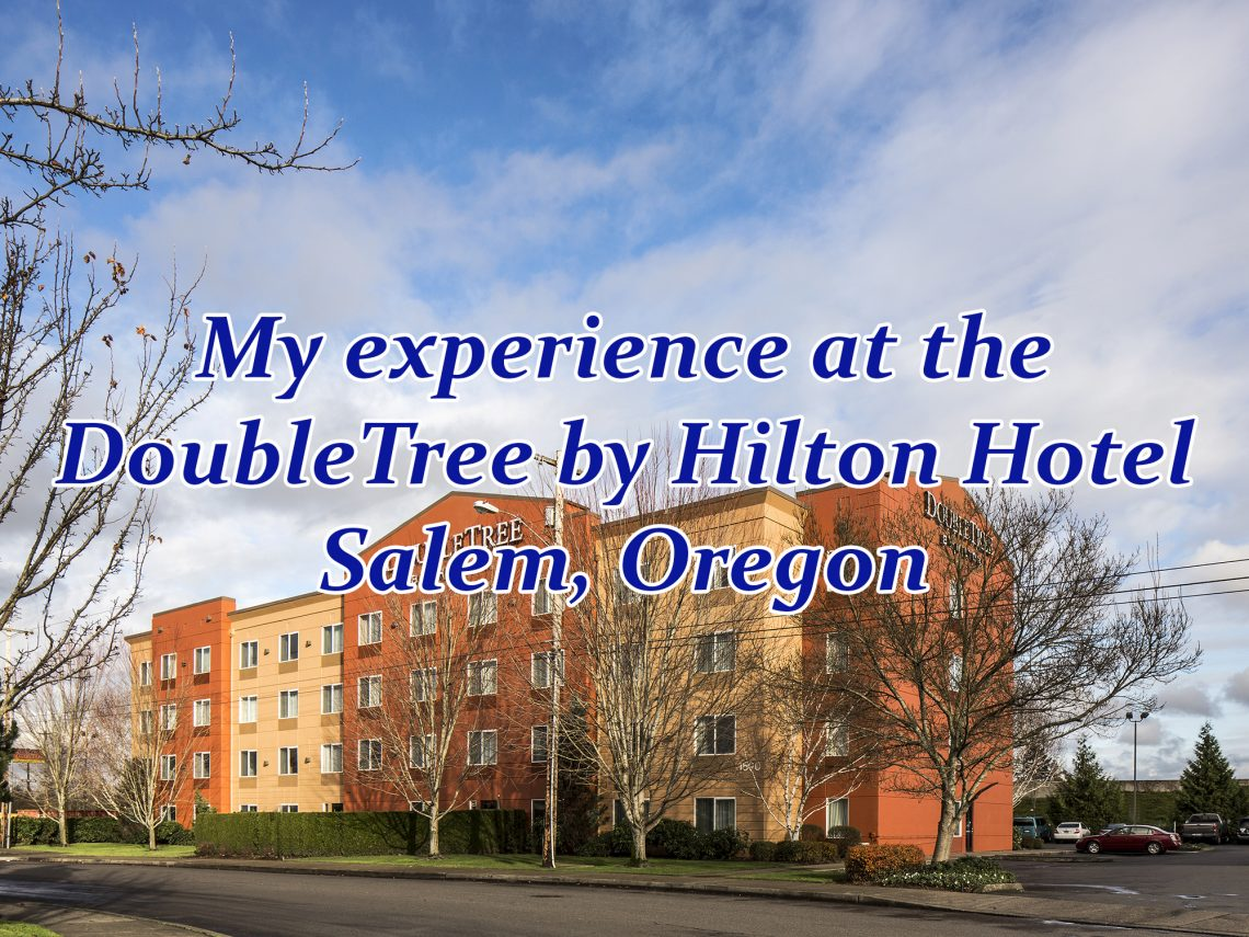 "Exterior overview of a large hotel building with text overlaying it that says, ""My experience at the DoubleTree by Hilton Hotel Salem, Oregon."""