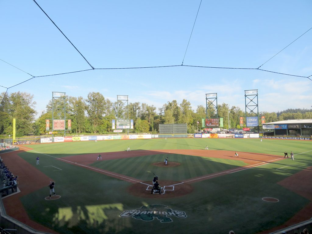 Overview of a baseball field as Eugene Emeralds pitcher Josh Burgmann delivers the first pitch to Boise Hawks center fielder Bladimir Restituyo.