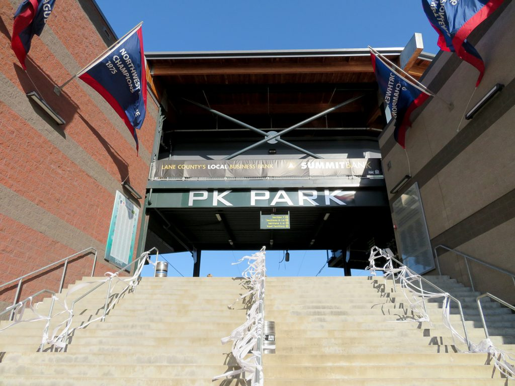 "Concrete staircase with sign at top that says ""PK Park."""