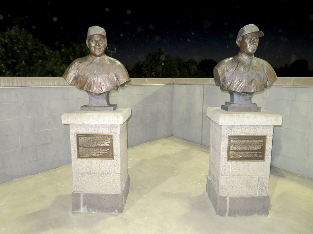Two bronze busts of University of Oregon men's baseball coaches.