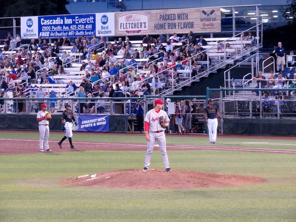 Spokane Indians right-handed pitcher Joe Corbett on the mound during a baseball game.