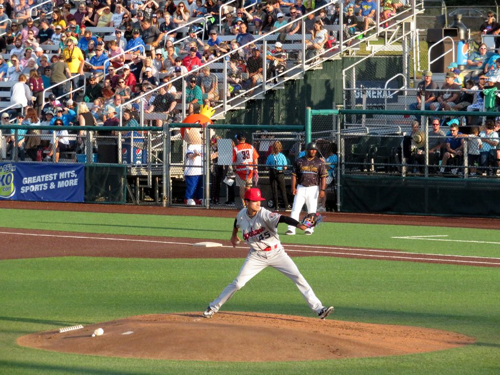 Spokane Indians right-handed pitcher Theo McDowell delivering a pitch.