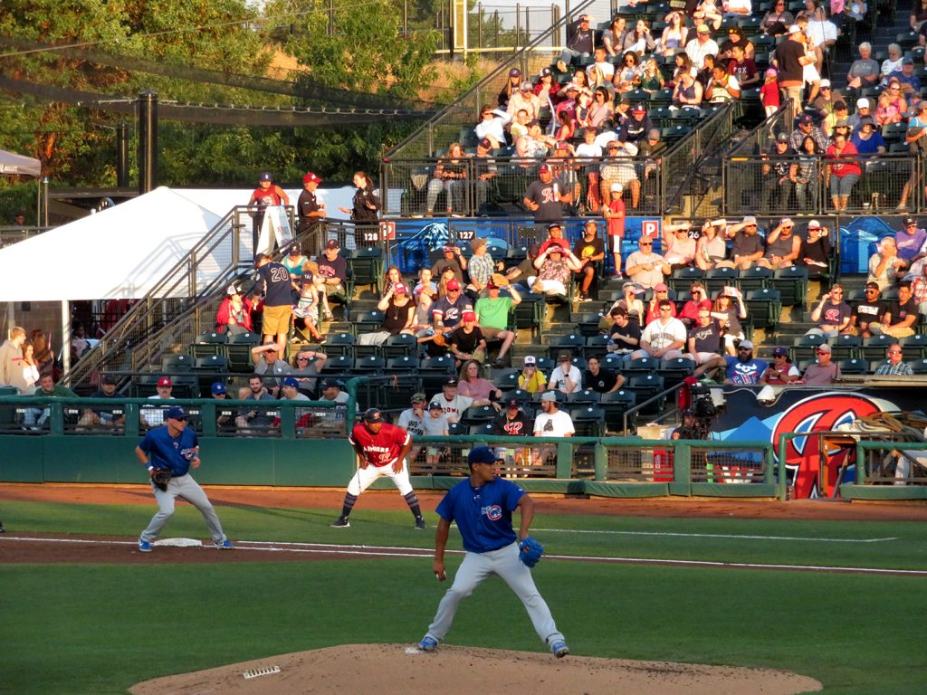 Iowa Cubs right-handed pitcher Adbert Alzolay delivers a pitch during a baseball game.