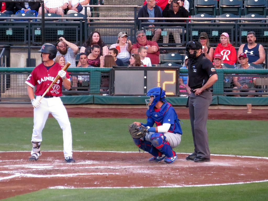 Tacoma Rainiers left-handed batting Jaycob Brugman stepping into the batter's box.