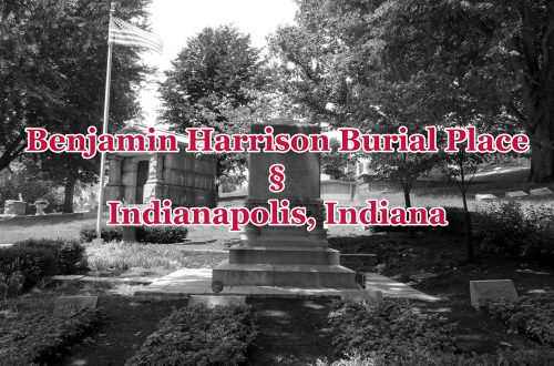 "Black-and-white overview of a family grave site with an obelisk in the center. Text overlays the image saying ""Benjamin Harrison Burial Place. Indianapolis, Indiana."""