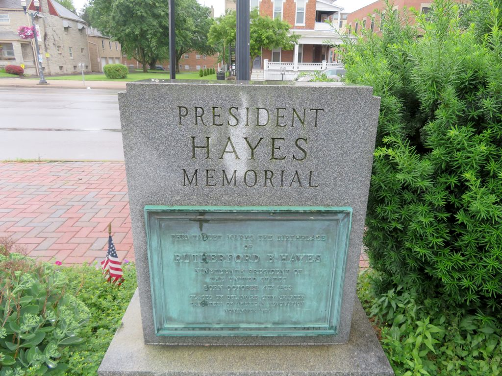 "View of a granite marker that says ""President Hayes Memorial"" that marks the birthplace of Rutherford B. Hayes."