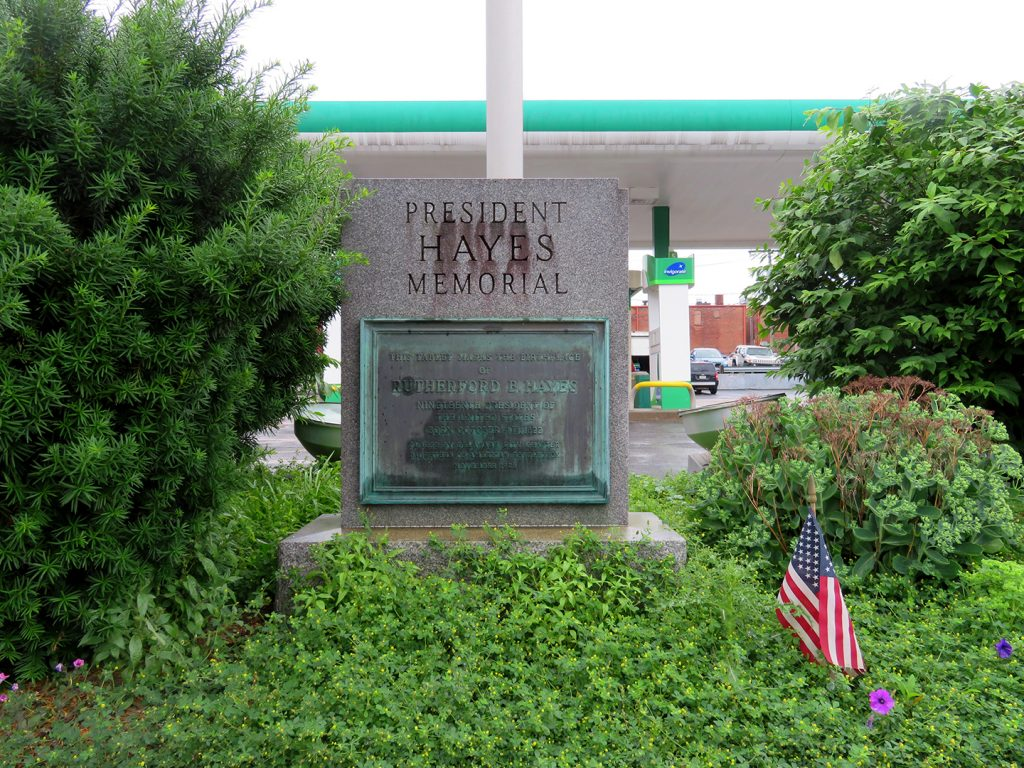 "A large granite marker says ""President Hayes Memorial"" marking the Rutherford B. Hayes birthplace."