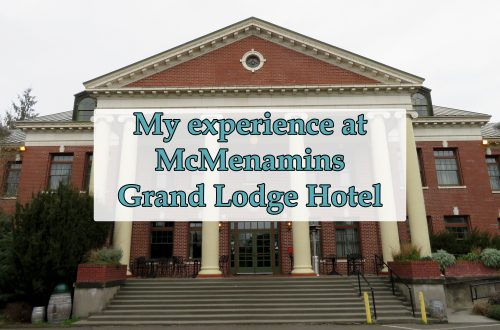 "Brick neoclassical designed building with white columns and a text box over the center that says ""My experience at McMenamins Grand Lodge Hotel."""