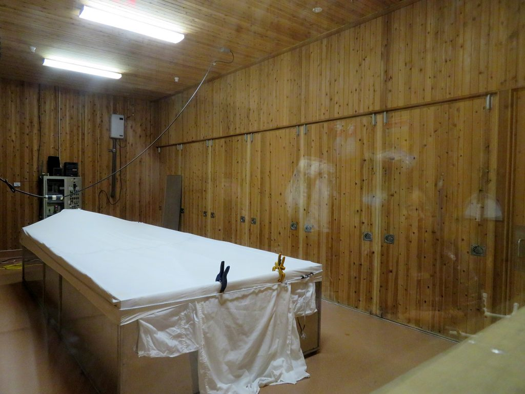 Large cedar room with a white cloth over a table where kōji is used to saccharify rice to produce sake.