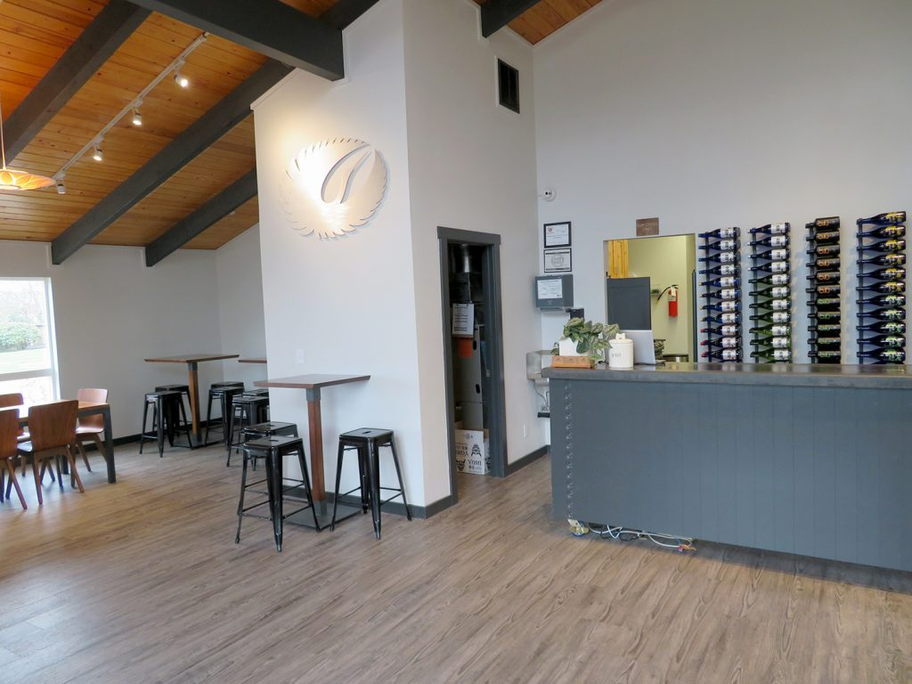 Overview of a counter on the right and seating to the left in the tasting room at SakéOne.
