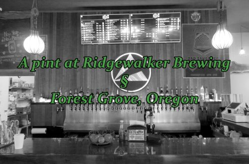 "Black-and-white photo showing a bar with a digital drink menu in the middle of the wall. Text overlays the image saying ""A pint at Ridgewalker Brewing § Forest Grove, Oregon."""