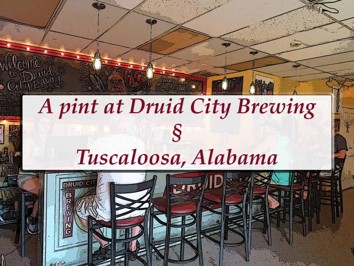 "Overview of a bar top with a white text box covering the image and text inside that says ""A pint at Druid City Brewing § Tuscaloosa, Alabama."""