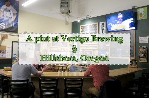 """Overview of a large corner bar with a opaque white box with green text that says """"A pint at Vertigo Brewing § Hillsboro, Oregon."""""""