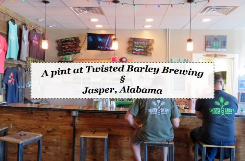 "Overview of a bar at a brewery with a white text box in the center that says, ""A pint at Twisted Barley Brewing § Jasper, Alabama."""