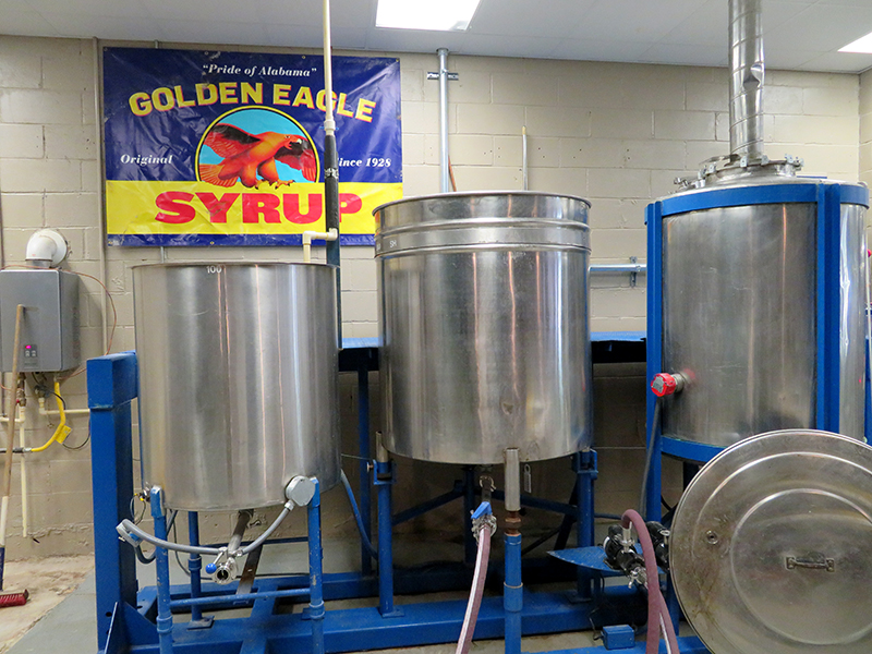Overview of a brewhouse with a banner for Golden Eagle Syrup hanging in the background.