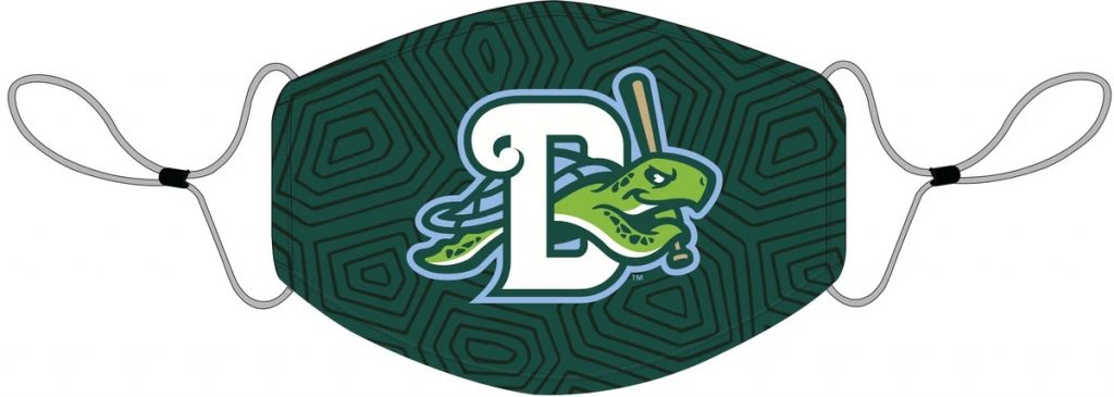 "Daytona Tortugas face mask with a sea turtle swimming through the letter ""D"" holding a baseball bat on dark green fabric."