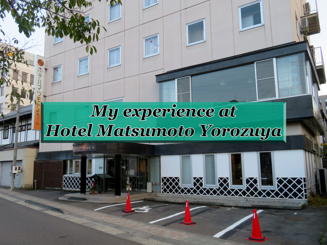 "Exterior of a multiple-story building with text inside a green box that says, ""My experience at Hotel Matsumoto Yorozuya."""